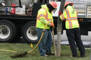 Workers from Blood Hound Underground perform a vacuum excavation demonstration.