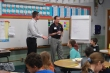 Jake Andersen and Tom Boardman of LJB explain programming to the fourth-grade class.