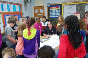 LJB principal Tom Boardman works with fourth-grade students from Mills Lawn Elementary School (Yellow Springs, Ohio) on the design of a new elementary school