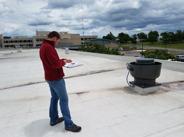 LJB's Dan Buck performs a fall hazard risk assessment on a hospital roof
