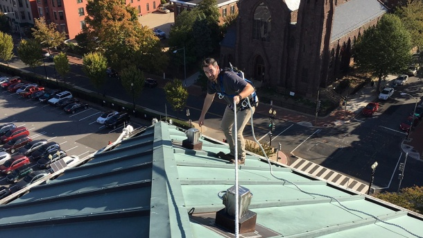 LJB's Hunter Meadors performs a fall protection inspection on a roof